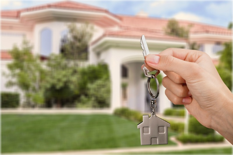 Image of keys being held up to a new house