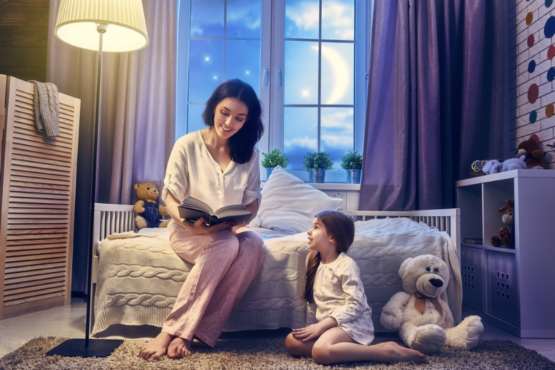 Image of a parent reading to a child
