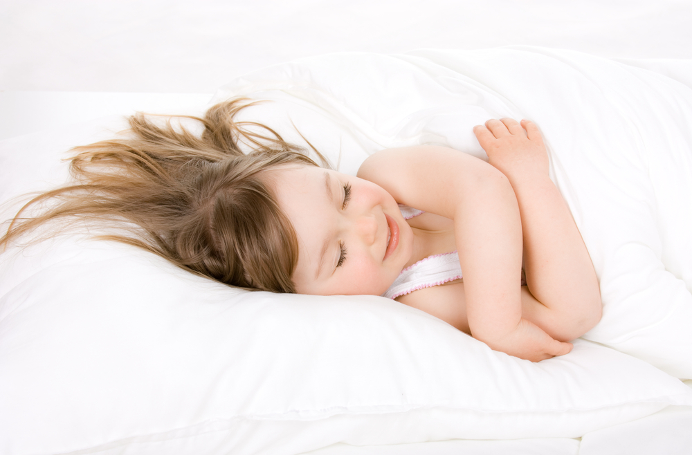 Dreams Meanings - Young girl dreaming in bed