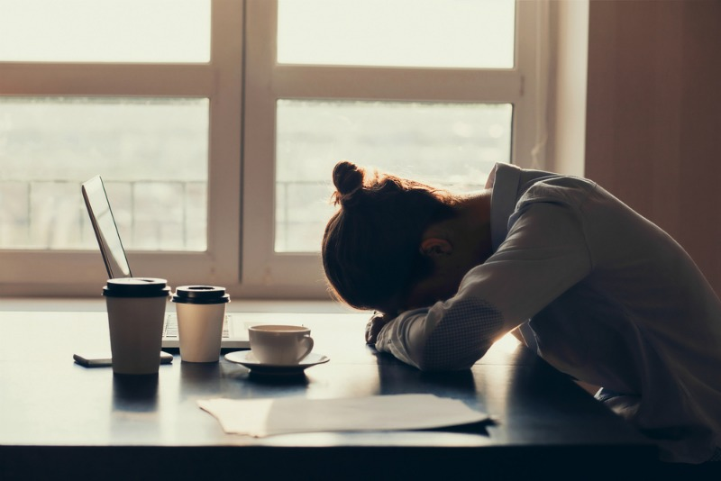 An image of a tired woman demonstrating chronic fatigue