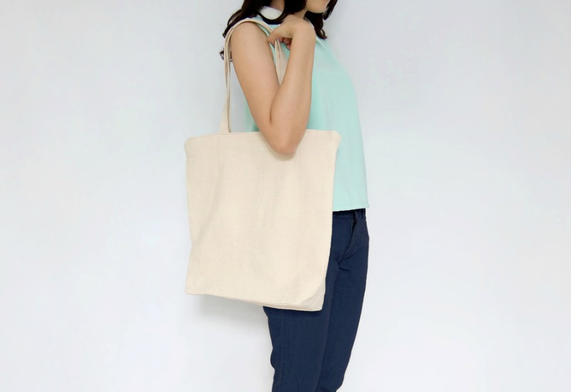 Woman holding tote bag