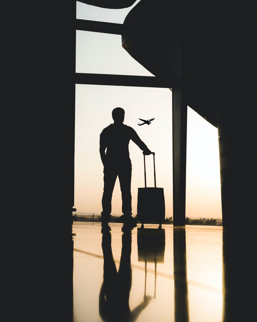 silhouette of man at airport