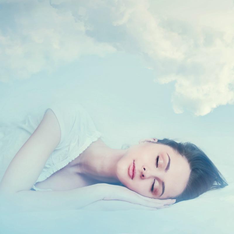 Lucid dreaming - Woman asleep dreaming