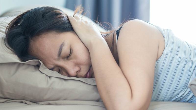 Woman suffering from noise pollution